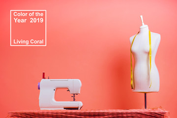 Color of the year 2019 Living coral Pantone.seamstress workplace garment factory tailor maniken, designer sewing machine