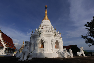 White Lion Statue with white pagoda of the temple of Thailand