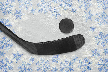 Hockey stick and puck at the winter hockey arena