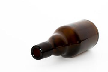 Leere braune Flasche