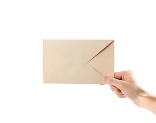 The hand holding the envelope. Close up. Isolated on white background