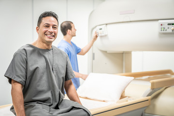 Portrait Of Happy Man Smiling As Patient In Clinic