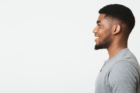 Happy smiling young african-american man profile portrait