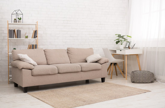 Modern living room design with sofa, copy space