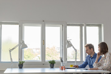 Business man and woman working together in an office