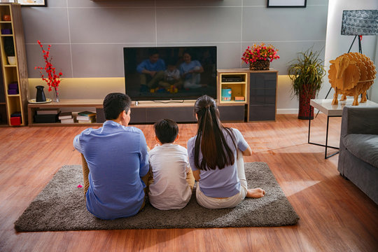 Happy families are watching TV