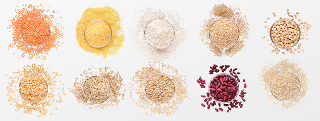 Assortment of scattered grains in glass bowls Wall mural