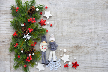 Christmas decorations and spruce branches on a wooden background. Top view, copy space. Christmas or New Year greeting card.