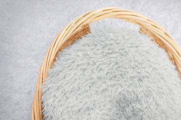 Wicker basket, with blue fur and blue background