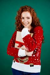 Cheerful girl embracing christmas present