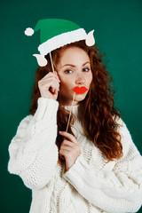 Playful girl in elf costume at studio shot