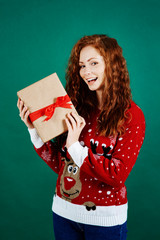 Portrait of happy girl holding christmas present