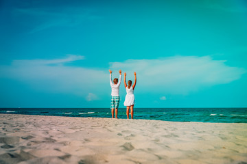 happy loving couple on tropical beach vacation