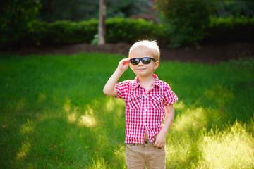 funny little boy in sunglasses. Child boy in sunglasses