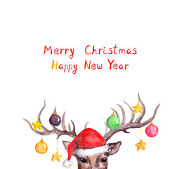 Christmas card - deer animal head in red holiday hat with decorative baubles on horns. Watercolor