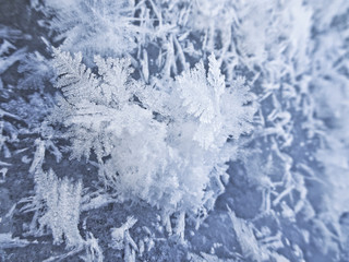 Winter mood - Snowflake crystals are lying on the ice
