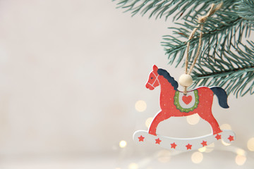 Christmas wooden toy in form red horse