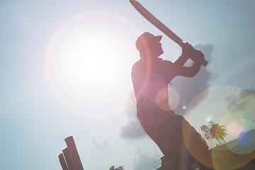 CHENNAI, INDIA - JUNE 25, 2016: Boy playing cricket at sunlight background