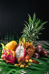 Set of exotic fruits. Assorted tropical fruits of pineapple, rambutan, passion fruit, mango, dragon fruit, longan