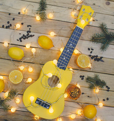 Photo shot, top view of Guitar, Lemons on Wooden Background.