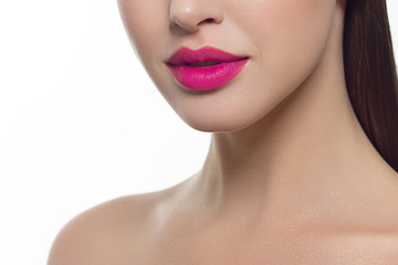 Closeup of beautiful female mouth with pink lip makeup.
