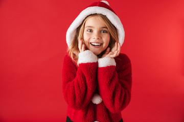Cheerful little girl wearing Christmas costume