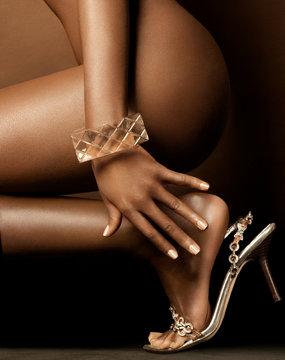 Dark Skinned Woman Crouching