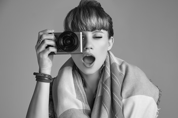 Beautiful glamour blond hippie woman taking picture on camera