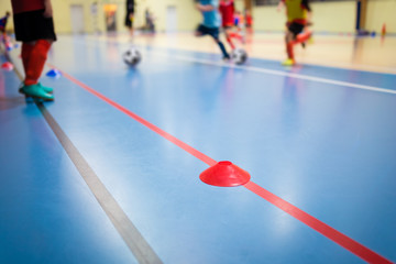 Group of Kids Training Indoor Soccer Futsal. Children Physical Education Class. Gym Class for Youth. Futsal Training Picture with Blurred Background