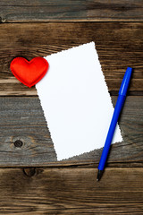 valentines day. empty blank, blue pen and red heart