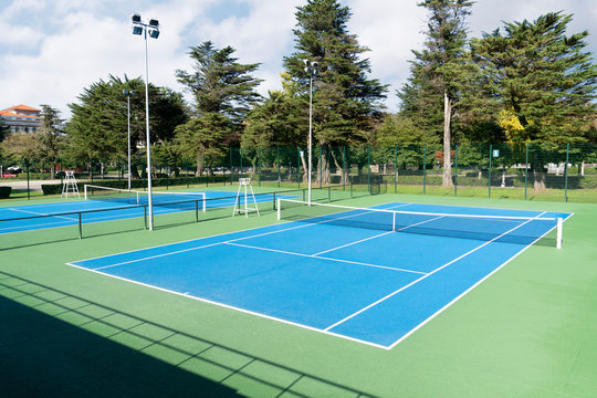 Blue Tennis court. Outdoor sunny day. Tennis concept. Copy space