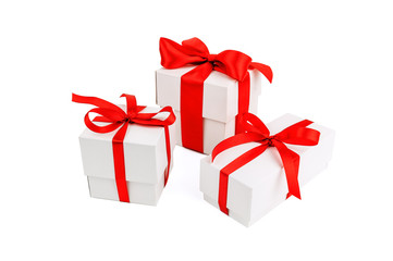 three red ribbon gift boxes