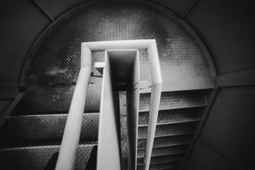 Metal spiral stairway inside jail in Oviedo, Spain