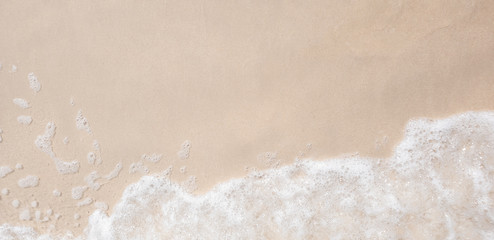 white ocean wave on sandy beach in summer vacation copy space for your text