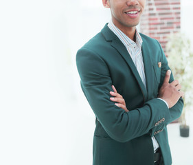 closeup.successful young businessman standing in office. business people