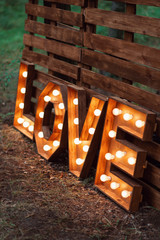 handmade glowing love letters. modern wedding decoration outdoors