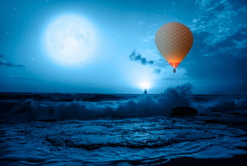 "Hot air balloon over the stormy sea against super blue full moon and lighthouse at night"" Elements of this image furnished by NASA"""