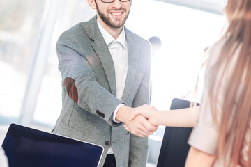 concept of a reliable partnership - the lawyer and the client, shake hands after signing the financing contract