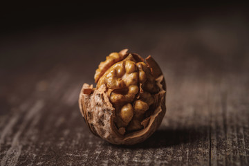 close up view of shelled walnut on wooden tabletop