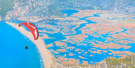 Foto op Aluminium Luchtsport Paraglider flies in the sky - Iztuzu beach, Turkey