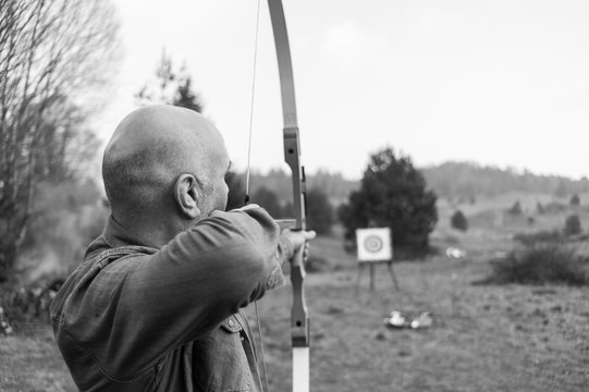 archer aiming bow