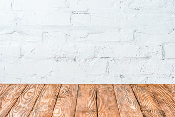 white brick wall and rustic wooden table