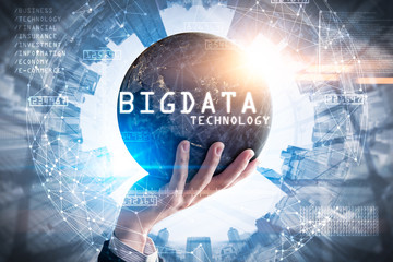 The double exposure image of the businessman hold the big data hologram on hand and element of this image furnished by Nasa. The concept of big data, hardware, futuristic, information and technology.