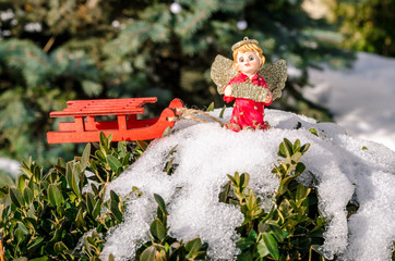 Winter angel figure with sleigh red new year in the snow on the Christmas tree concept