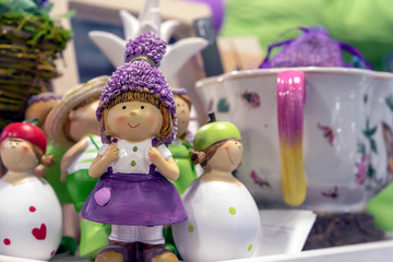 Figurine of a little girl in a lilac dress in a souvenir shop.