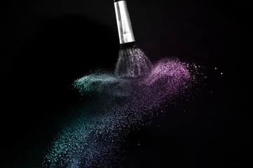 purple and blue ocean powder color splash and brush for makeup artist or graphic design in black background, look like a lively and joyful mood.