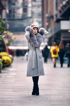 Gorgeous woman posing in luxurious fur coat