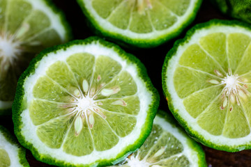 close up on sliced bergamot orange citrus for hair treatment product
