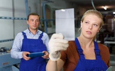 Woman working in glass workshop