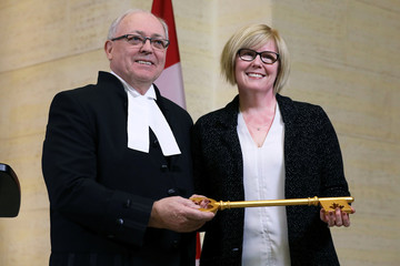 Canada's Public Services Minister Carla Qualtrough presents Senate Speaker George Furey with a ceremonial key in Ottawa